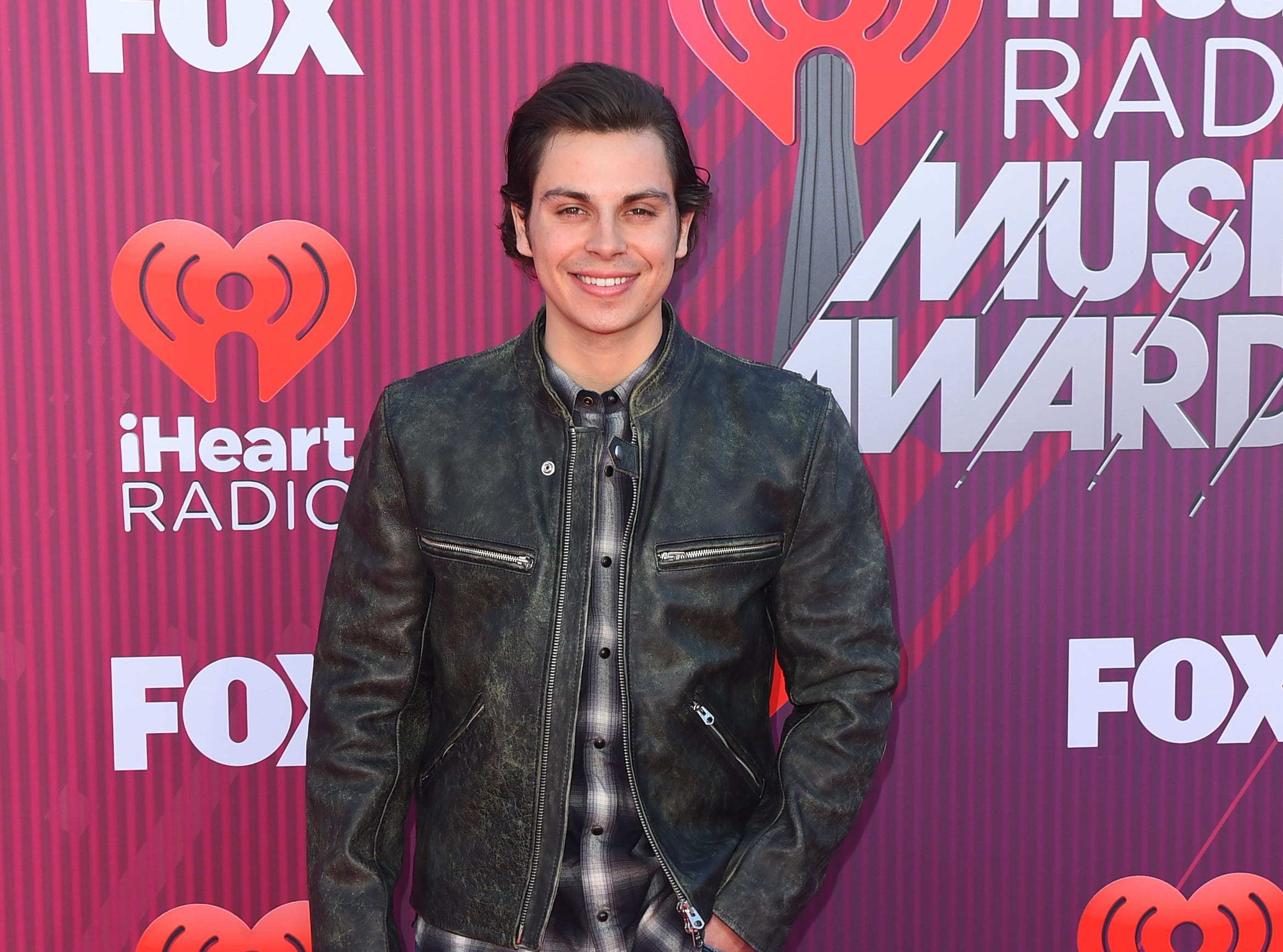 Jake T. Austin arrives at the iHeartRadio Music Awards.