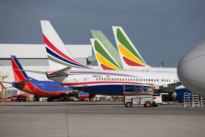 A gaggle of tails, including Ethiopian Airlines, Swift Air, and Southwest are seen from the ramp at Miami International Airport in February 2019.