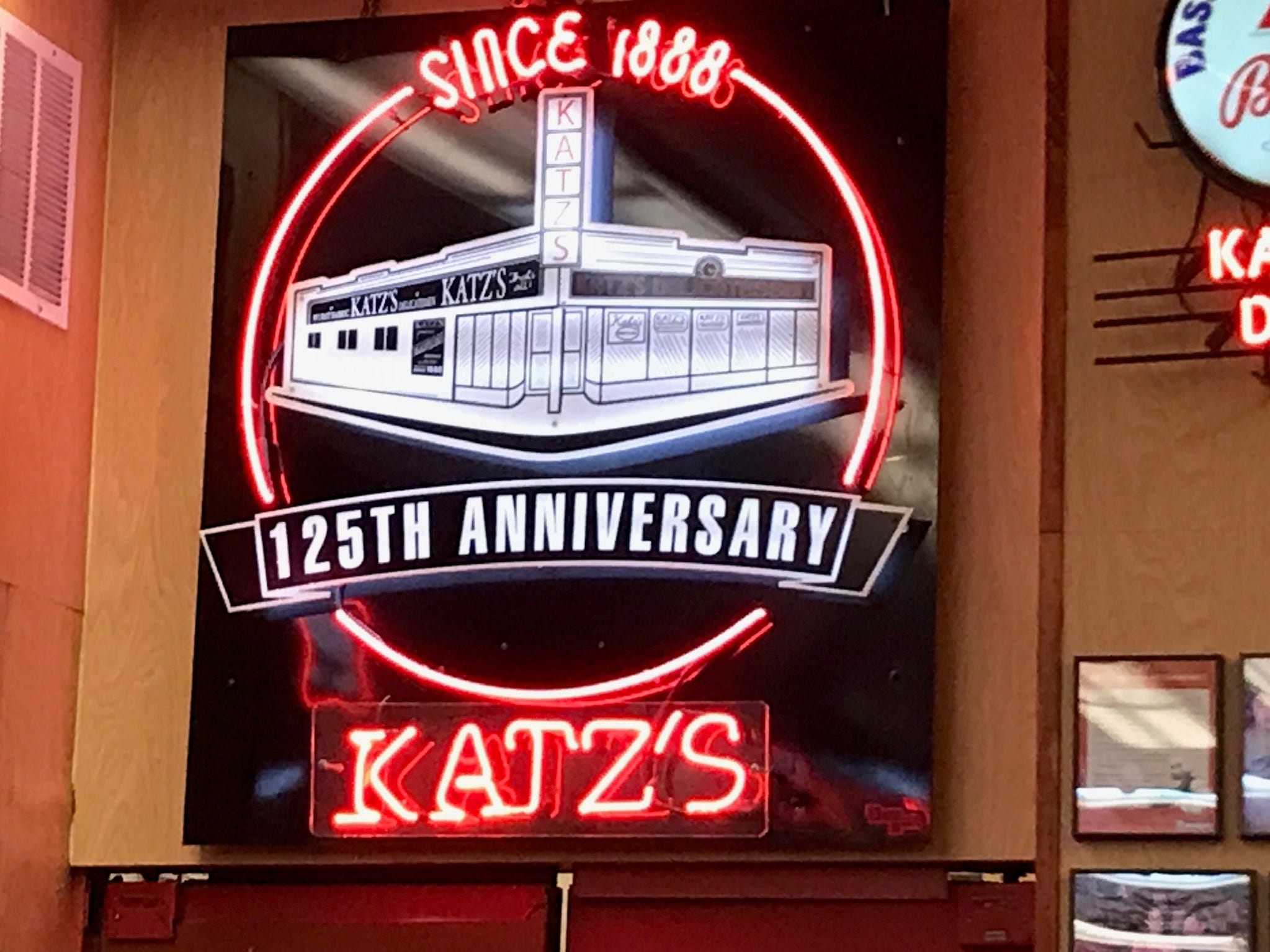 The 125th anniversary neon sign is already dated, since that special occasion happened in 2013.