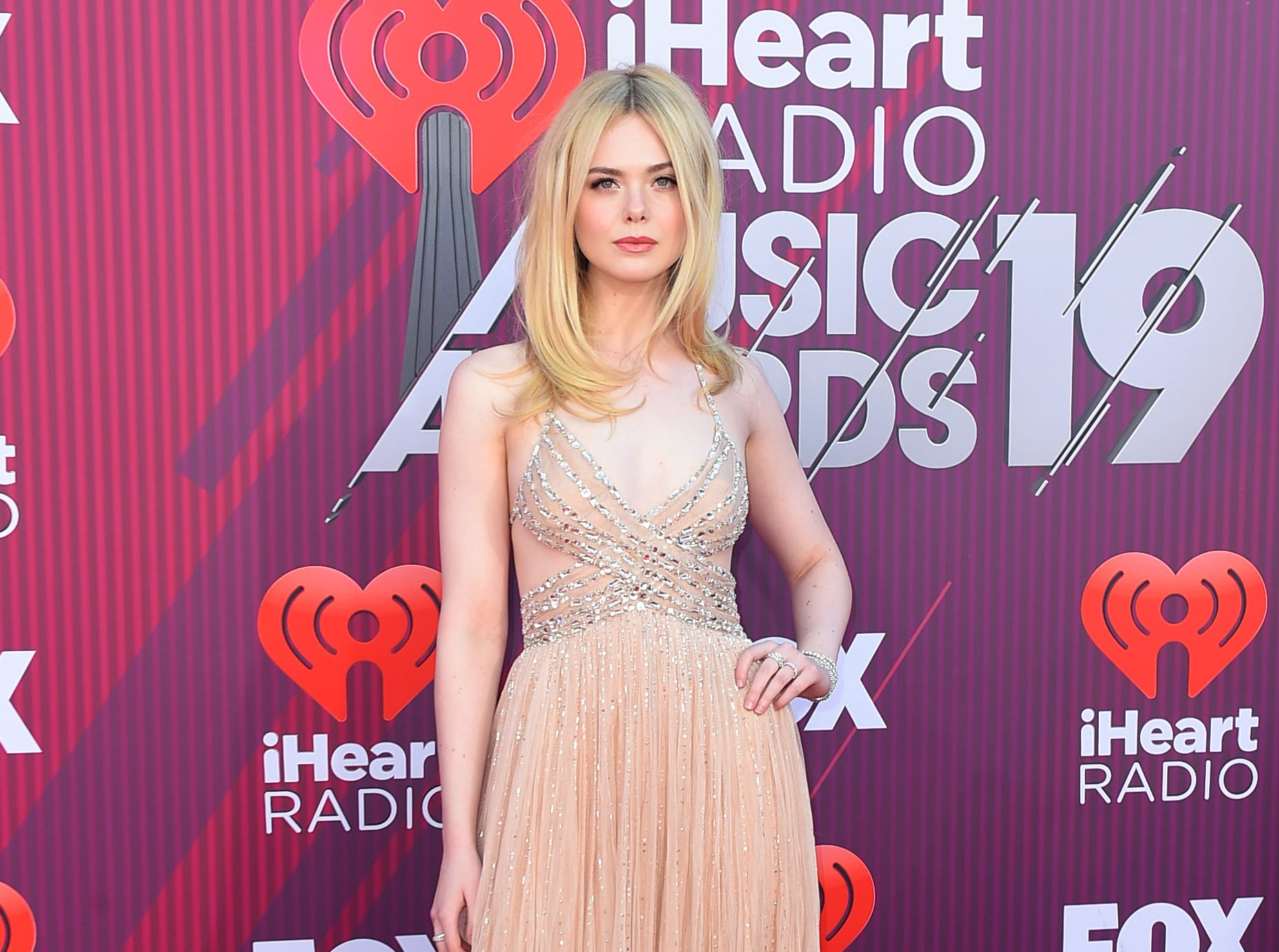 Elle Fanning arrives at the iHeartRadio Music Awards.