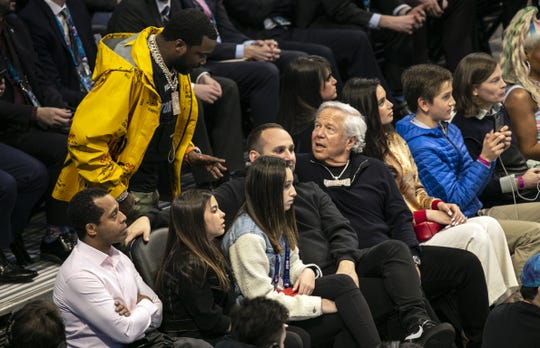 Robert Kraft talks to rapper Meek Mill while at the NBA All-Star Game last month.