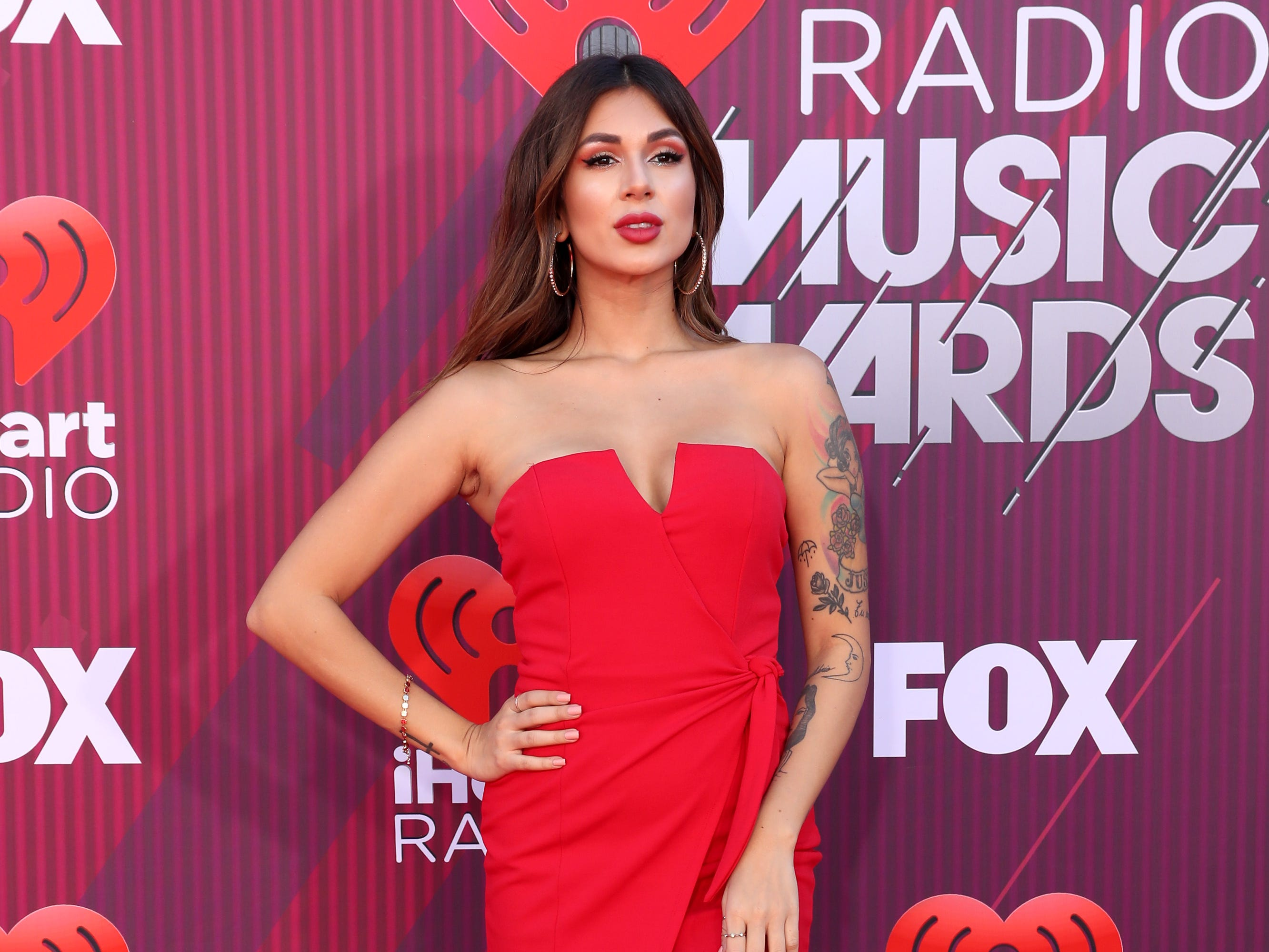 Valeria Sibaja arrives at the iHeartRadio Music Awards.