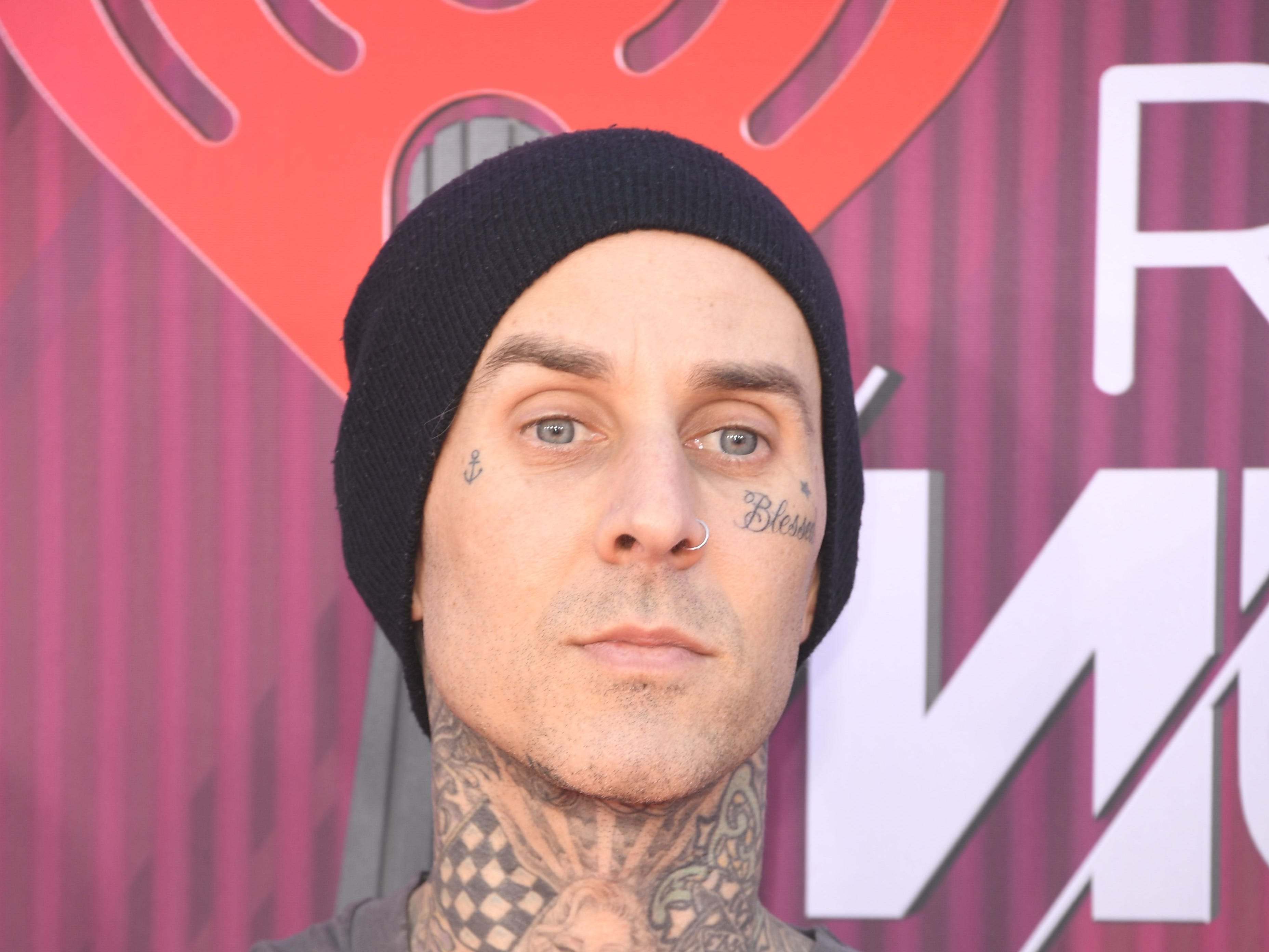 Travis Barker arrives at the iHeartRadio Music Awards.