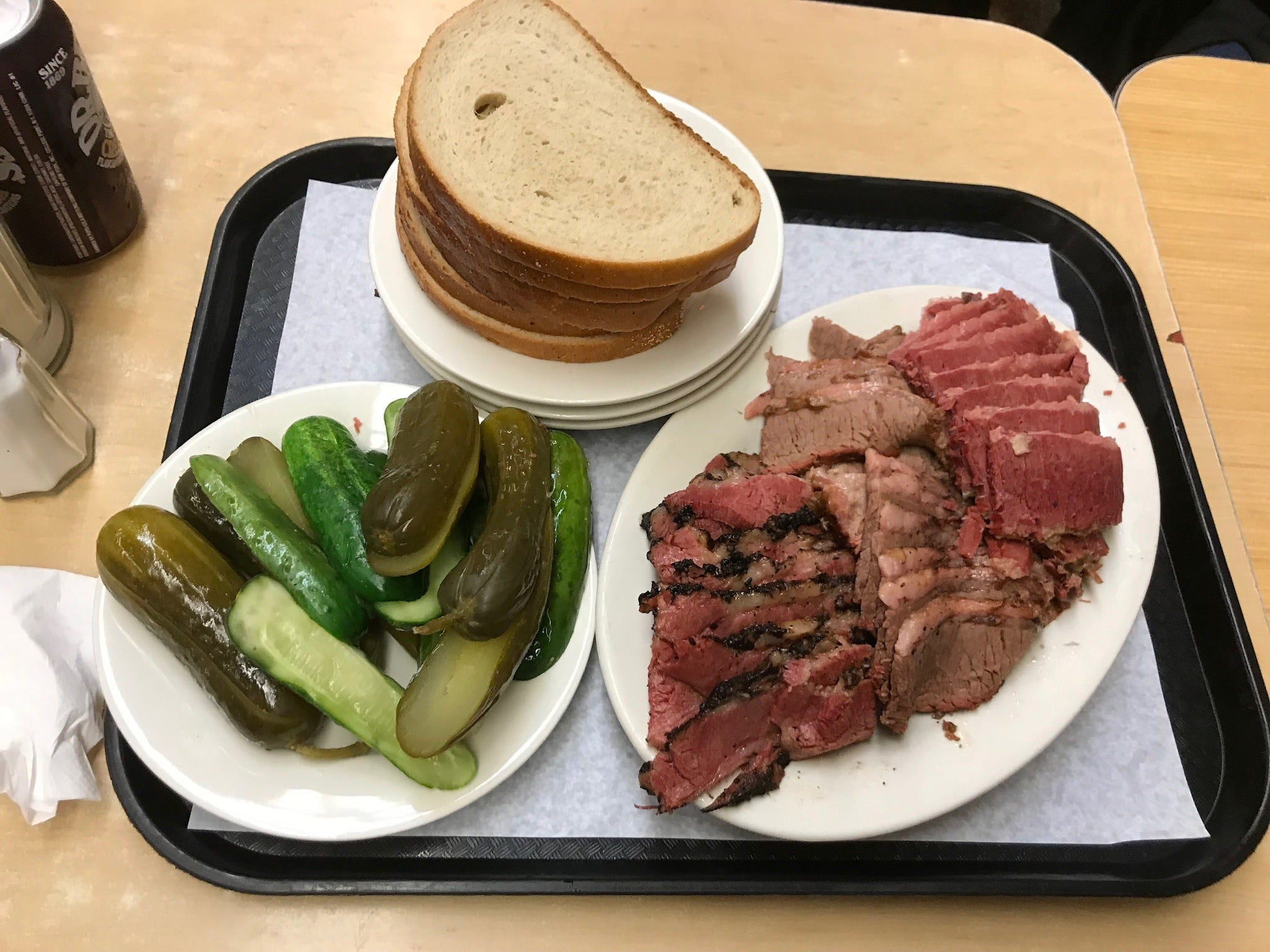 Many out-of-towners don't realize that instead of picking a single sandwich, you can opt for a shareable meat platter and make your own, trying all the specialties. This is pastrami (left), beef brisket (center) and corned beef (right) with a complimentary side of pickles and generous stack of rye bread.