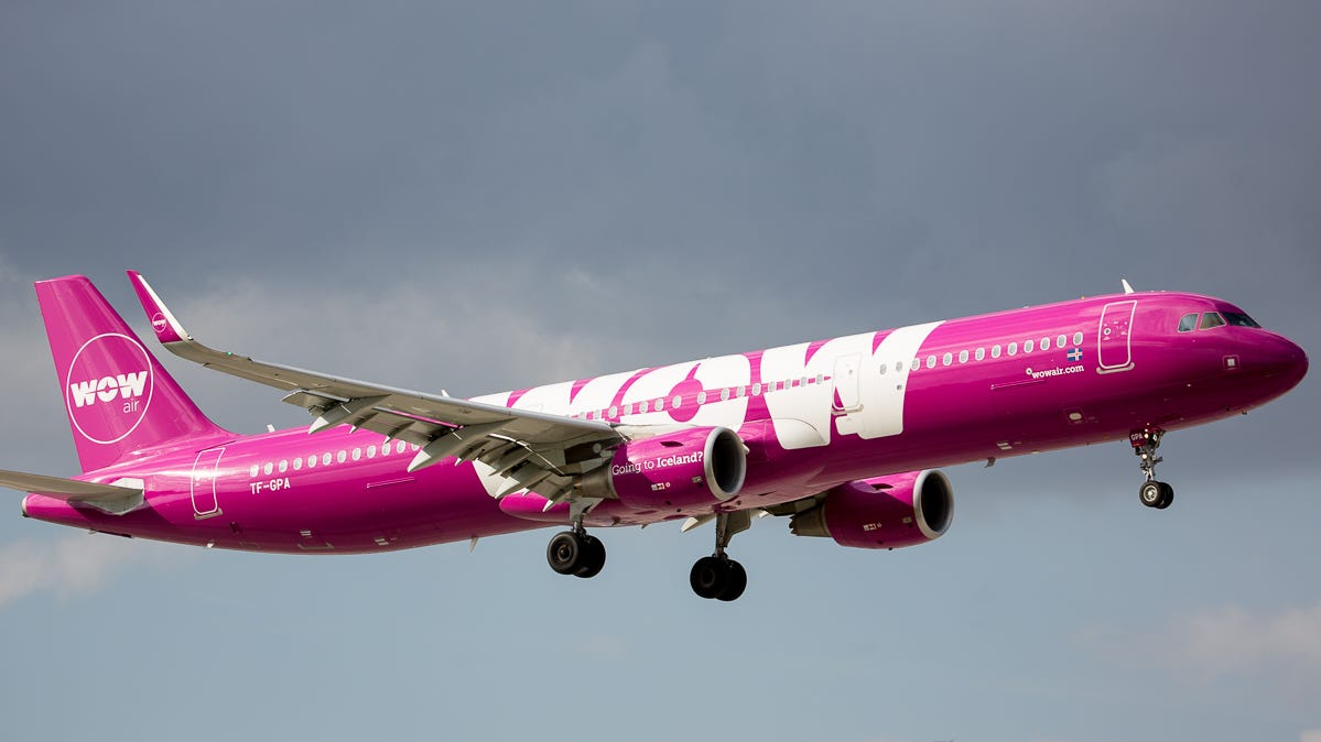 Running routes to the Caribbean, a WOW Air Airbus A321 lands at Miami International Airport in February 2019.