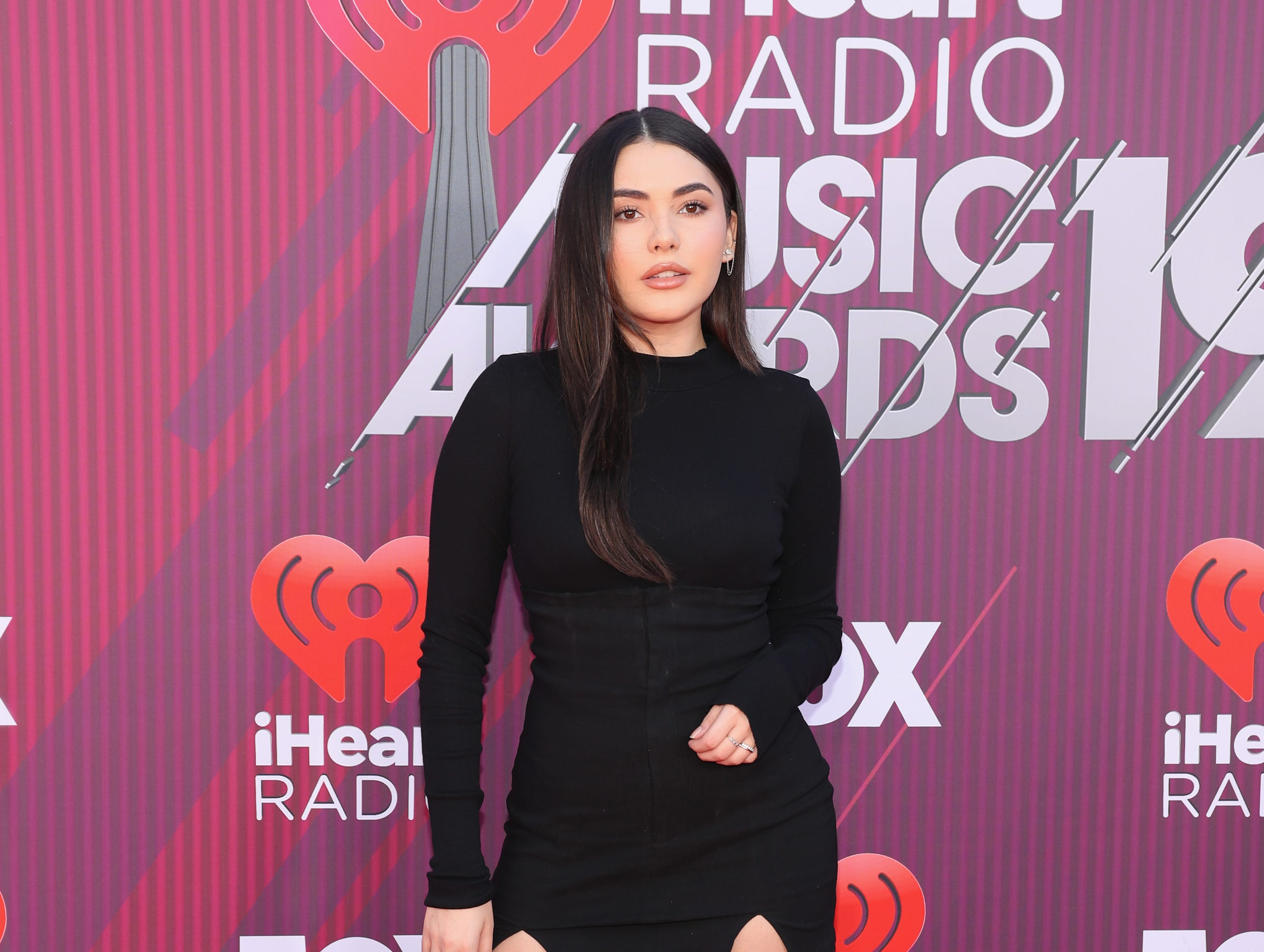 Atiana de la Hoya arrives at the iHeartRadio Music Awards.
