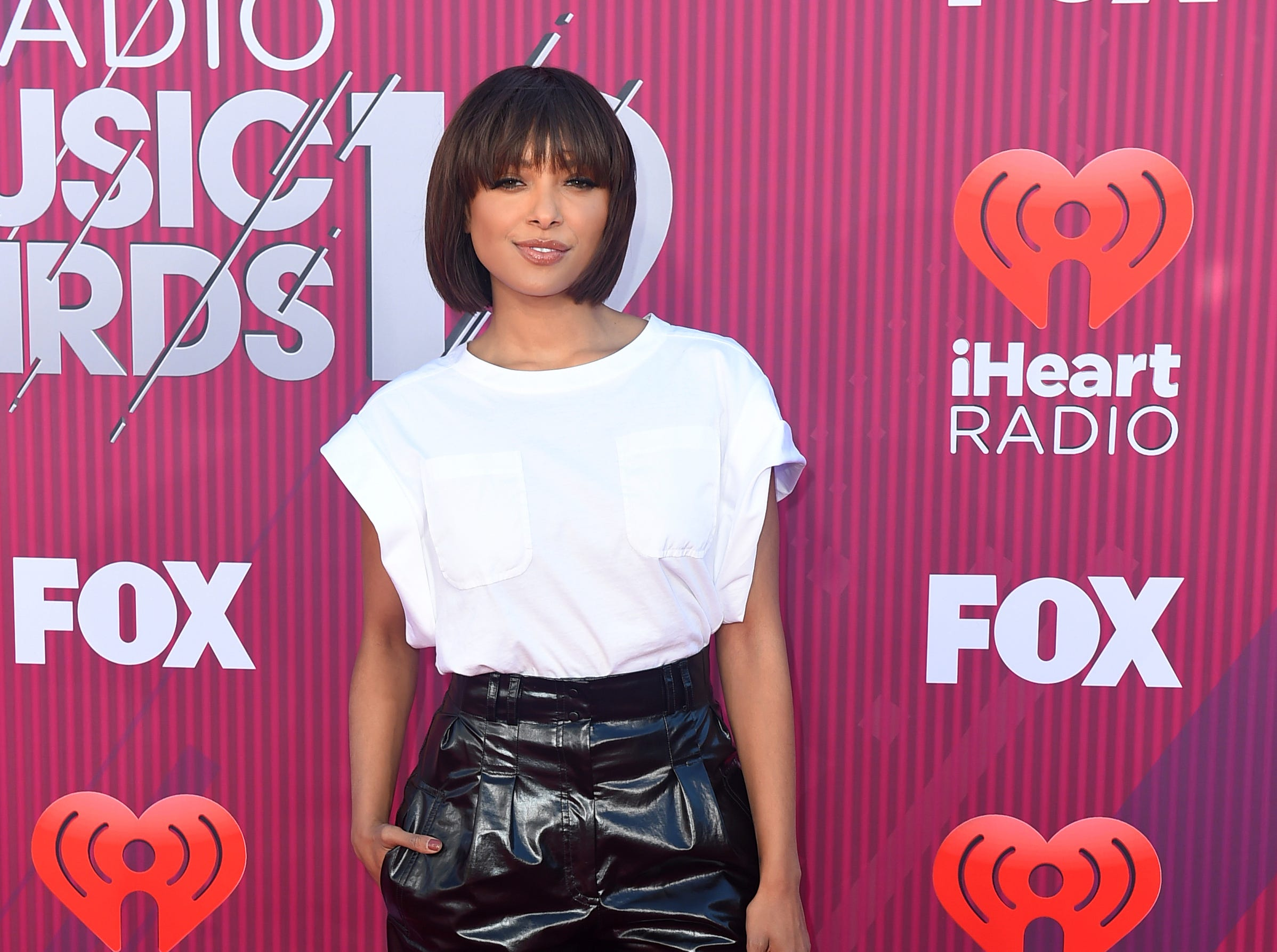 Kat Graham arrives at the iHeartRadio Music Awards.