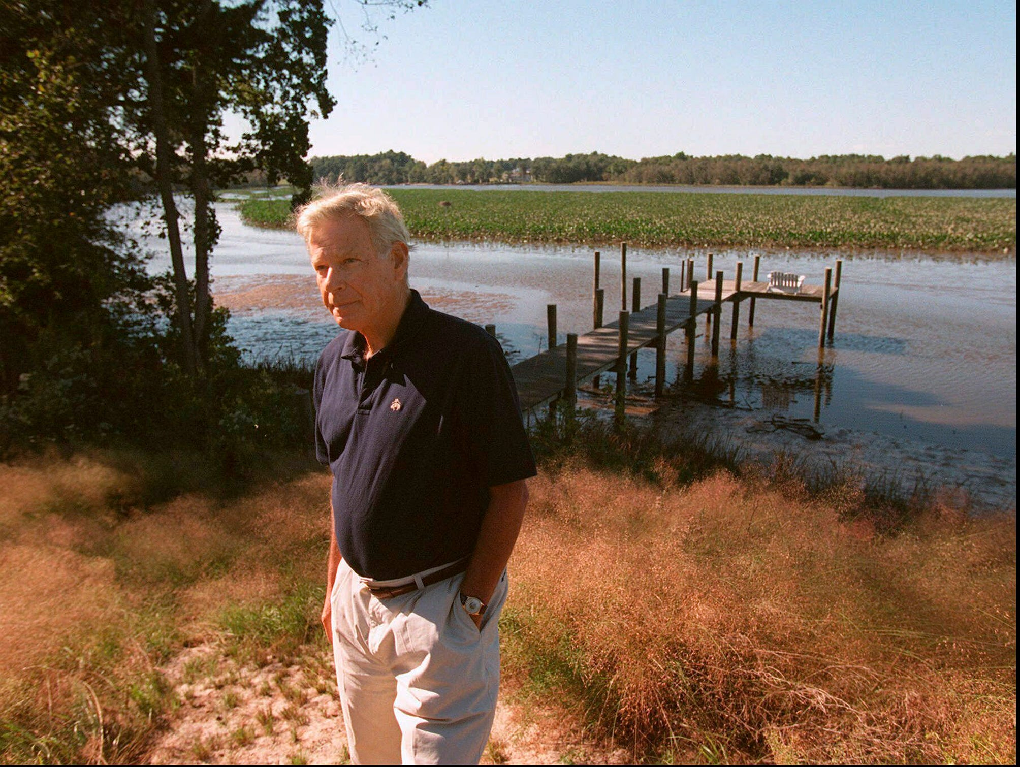 In a Sunday, Sept. 21, 1997 photo, former Maryland Governor Harry Hughes stands on the banks of his property on the Choptank River near Denton, Md. Former Maryland Gov. Harry R. Hughes, who prided himself on restoring public faith in the political process, died Wednesday, March 13, 2019. He was 92.