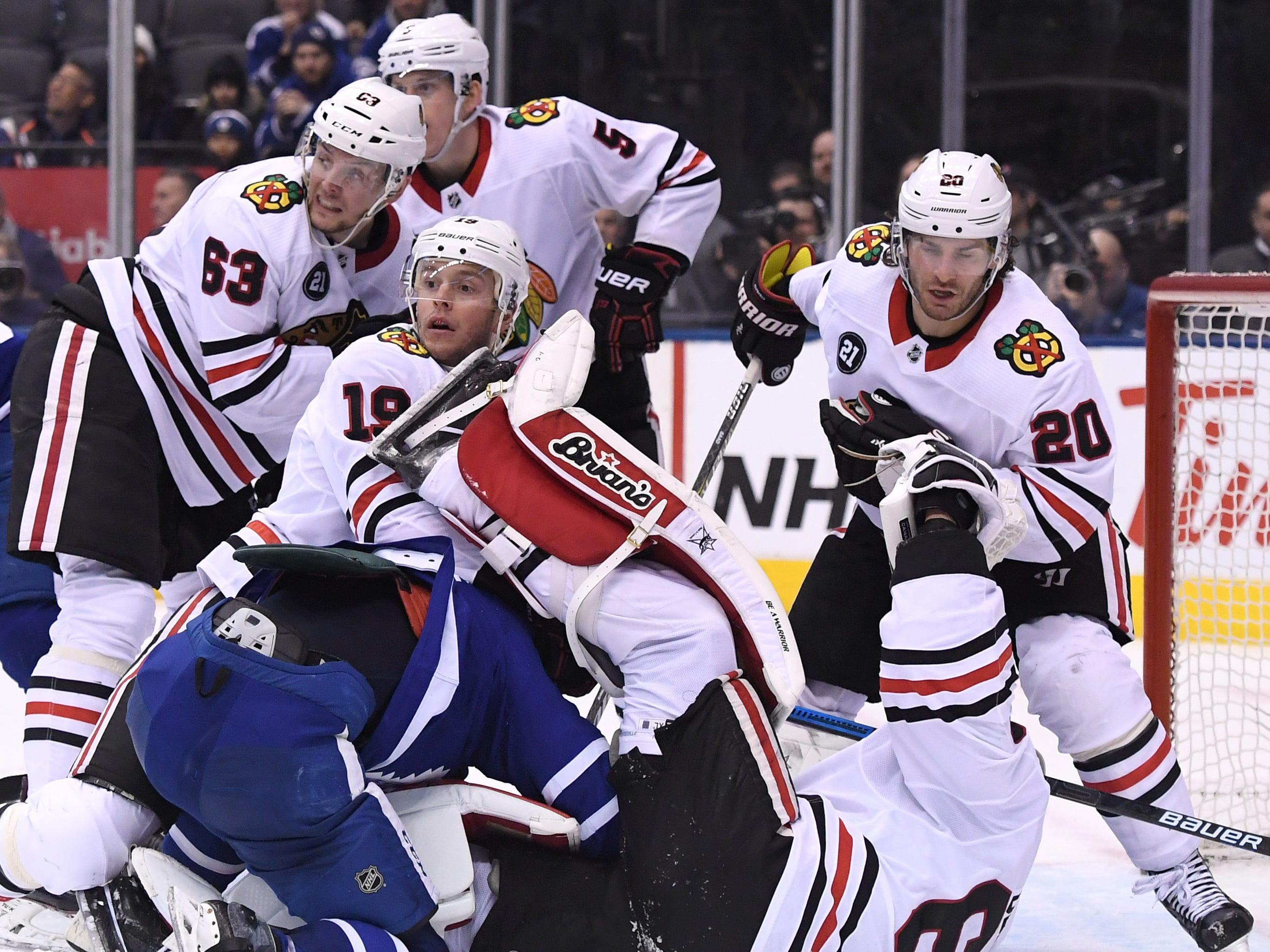 March 13:  Chicago Blackhawks goalie Collin Delia is knocked over by Toronto Maple Leafs forward Mitch Marner during the third period.