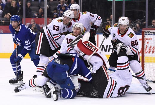 March 13  Chicago Blackhawks goalie Collin Delia is knocked over by Toronto  Maple Leafs forward d8c8d0d72