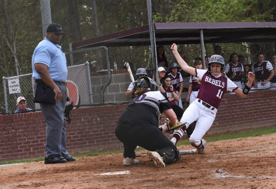 Alexandria Senior High's Jaislynn Meredino (10) tags Pineville's Alexis Roach out at home plate Thursday, March 14, 2019. Pineville won 4-1.