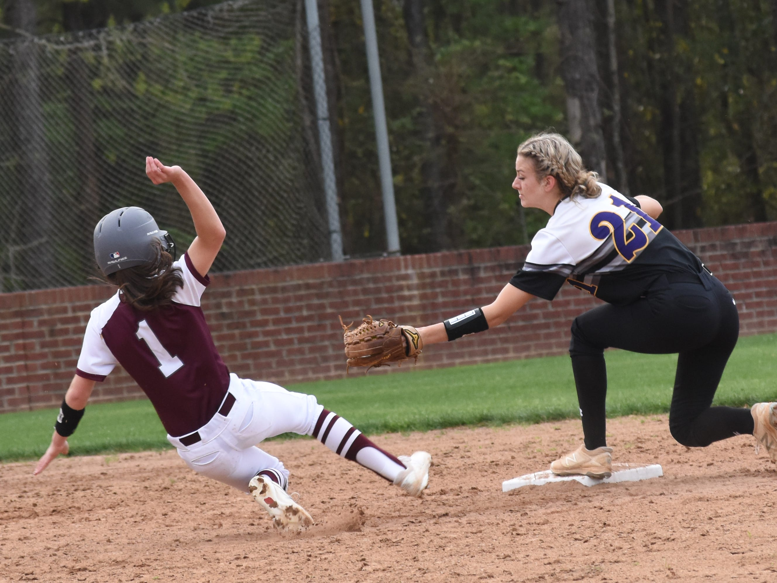 Pineville's Lauren Cooper (1) tries to reach second base against Alexandria Senior High School's Marlee Carruth Thursday, March 14, 2019. Pineville won 4-1.