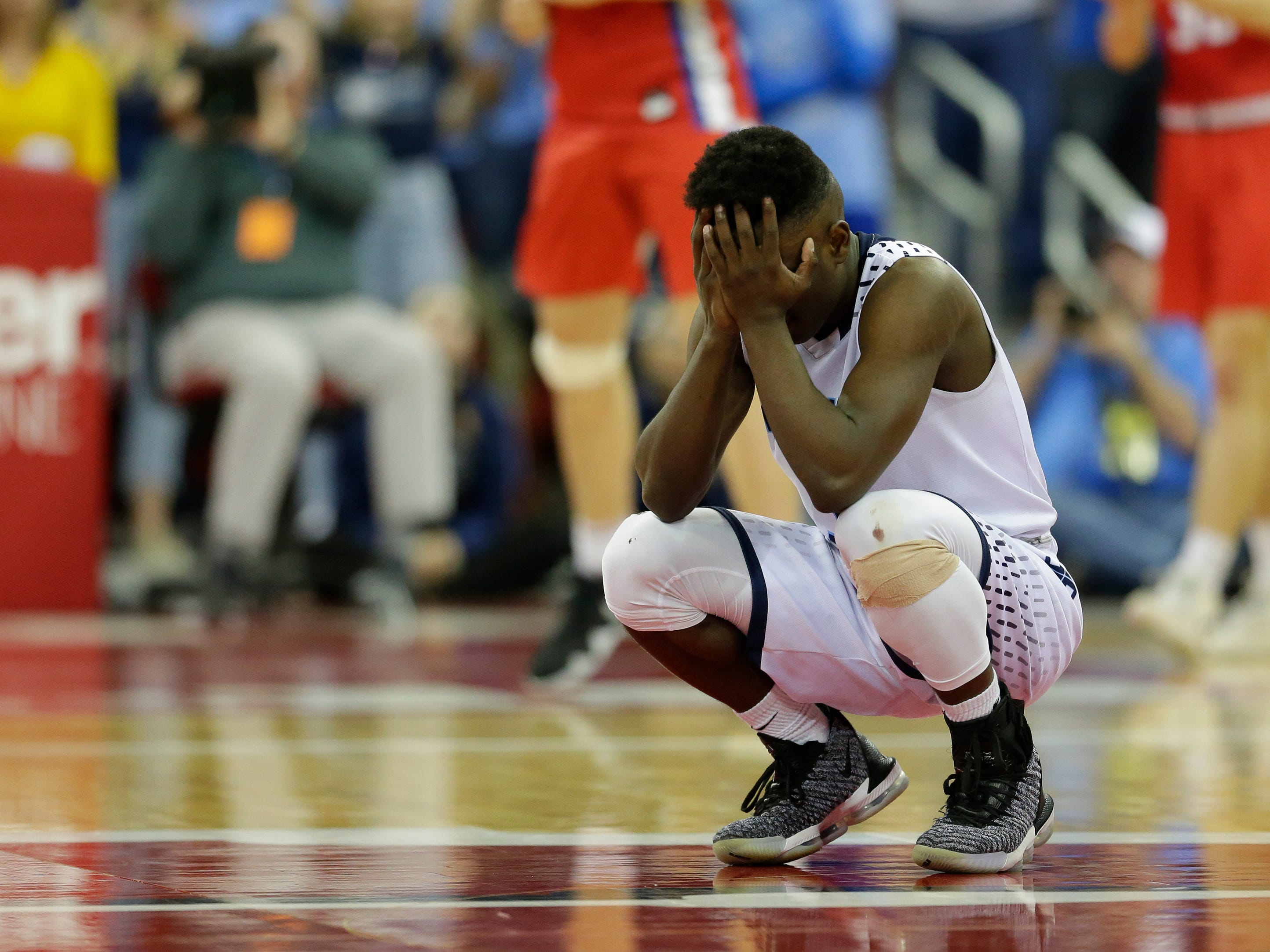 Roncalli High School's Chombi Lambert reacts after missing a shot in the final minute against New Glarus High School during their WIAA Division 4 boys basketball state semifinal at the Kohl Center Thursday, March 14, 2019, in Madison.