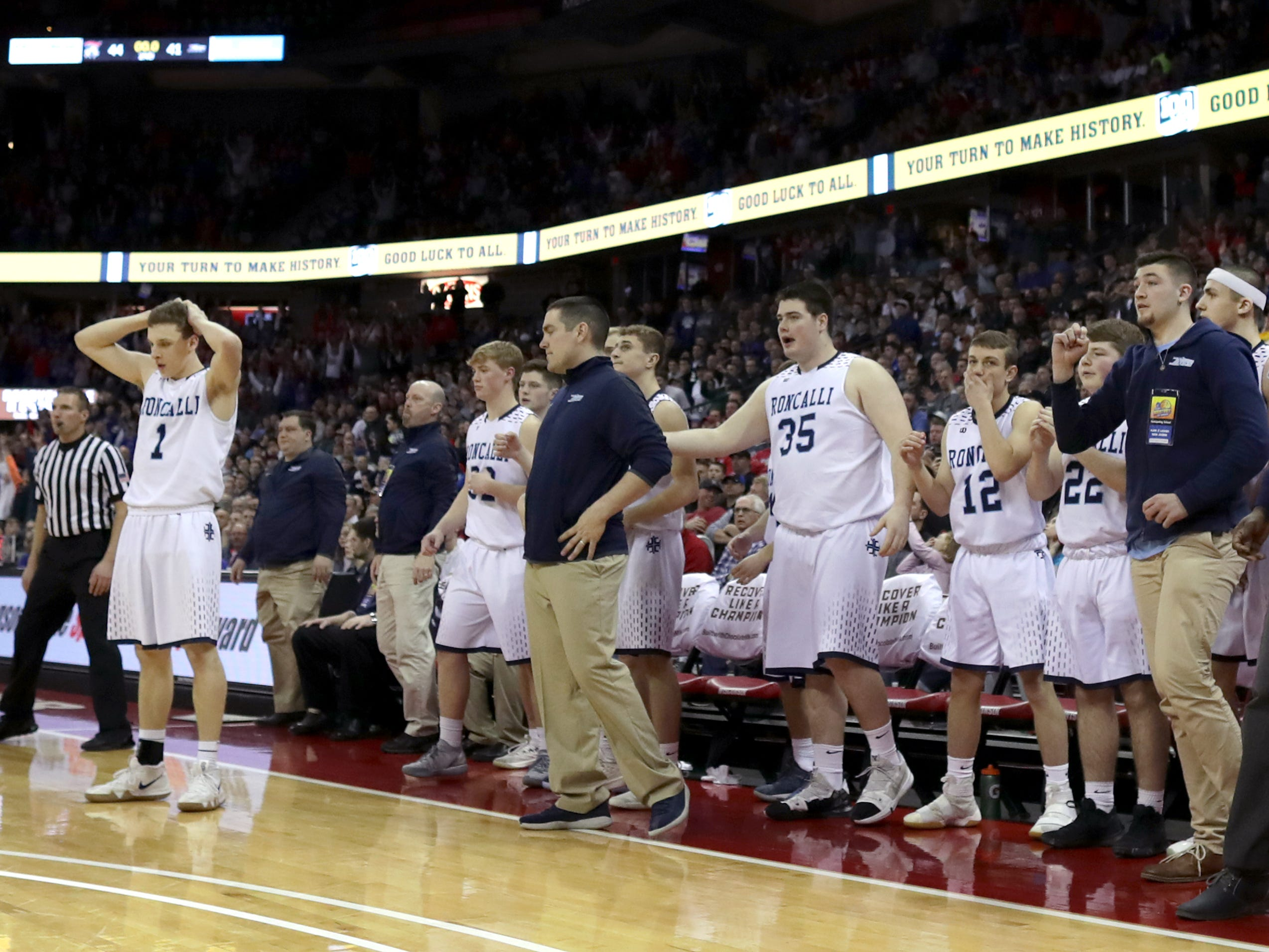 Roncalli High School's #1 Daniel Burgarino reacts as the clock runs out against New Glarus High School during their WIAA Division 4 boys basketball state semifinal on Thursday, March 14, 2019, at the KohlCenter in Madison, Wis. New Glarus defeated Roncalli 44 to 41. Wm. Glasheen/USA TODAY NETWORK-Wisconsin.