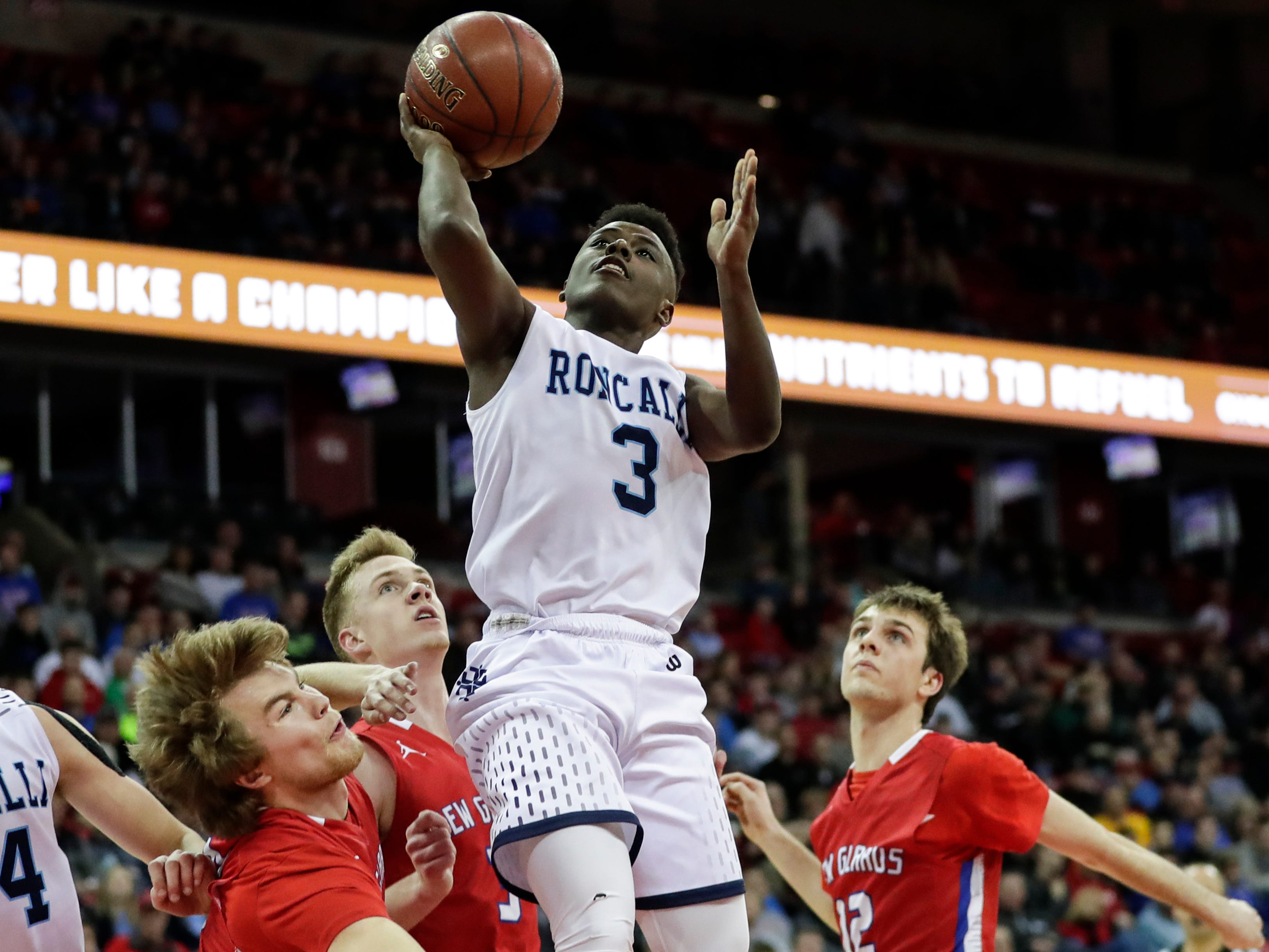 Roncalli High School's Chombi Lambert (3) shoots against New Glarus High School during their WIAA Division 4 boys basketball state semifinal at the Kohl Center Thursday, March 14, 2019, in Madison, Wis.