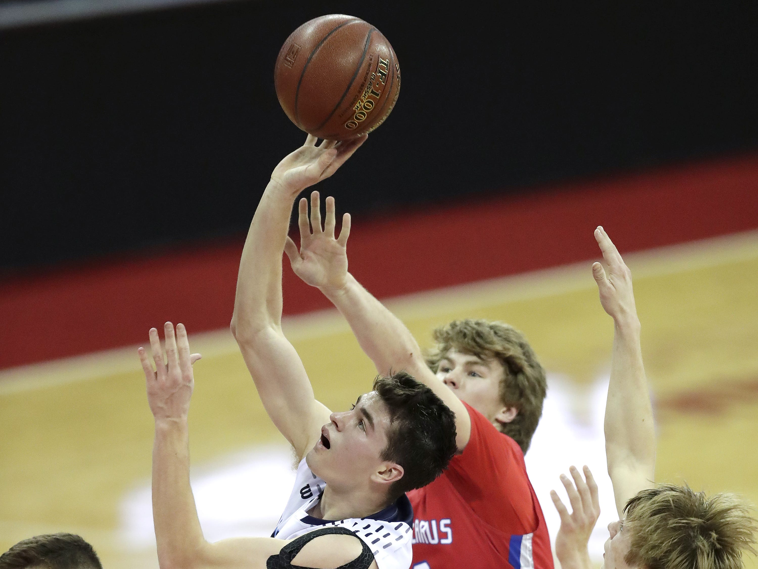 Roncalli High School's #34 Ian Behringer against New Glarus High Schoo during their WIAA Division 4 boys basketball state semifinal on Thursday, March 14, 2019, at the KohlCenter in Madison, Wis. New Glarus defeated Roncalli 44 to 41. Wm. Glasheen/USA TODAY NETWORK-Wisconsin.