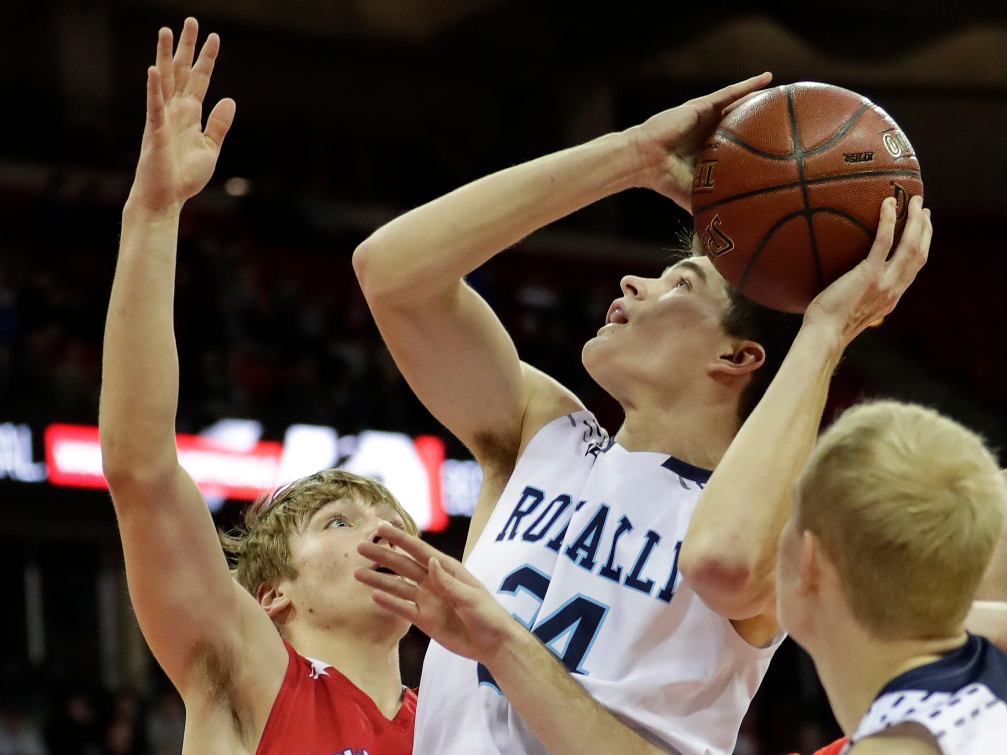 Roncalli High School's Ian Behringer (34) goes up for a layup against New Glarus High School during their WIAA Division 4 boys basketball state semifinal at the Kohl Center Thursday, March 14, 2019, in Madison, Wis.