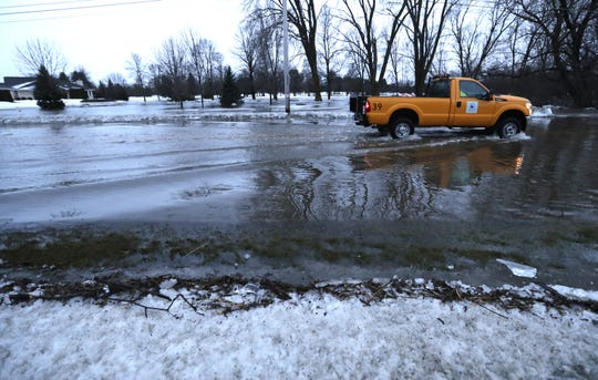 A city truck moves slowly along a flooded W. 9th Avenue Thursday, March 14, 2019, in Oshkosh, Wis.  Dan Powers/USA TODAY NETWORK-Wisconsin