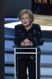 Betty White speaks onstage during the 70th Emmy Awards in September.