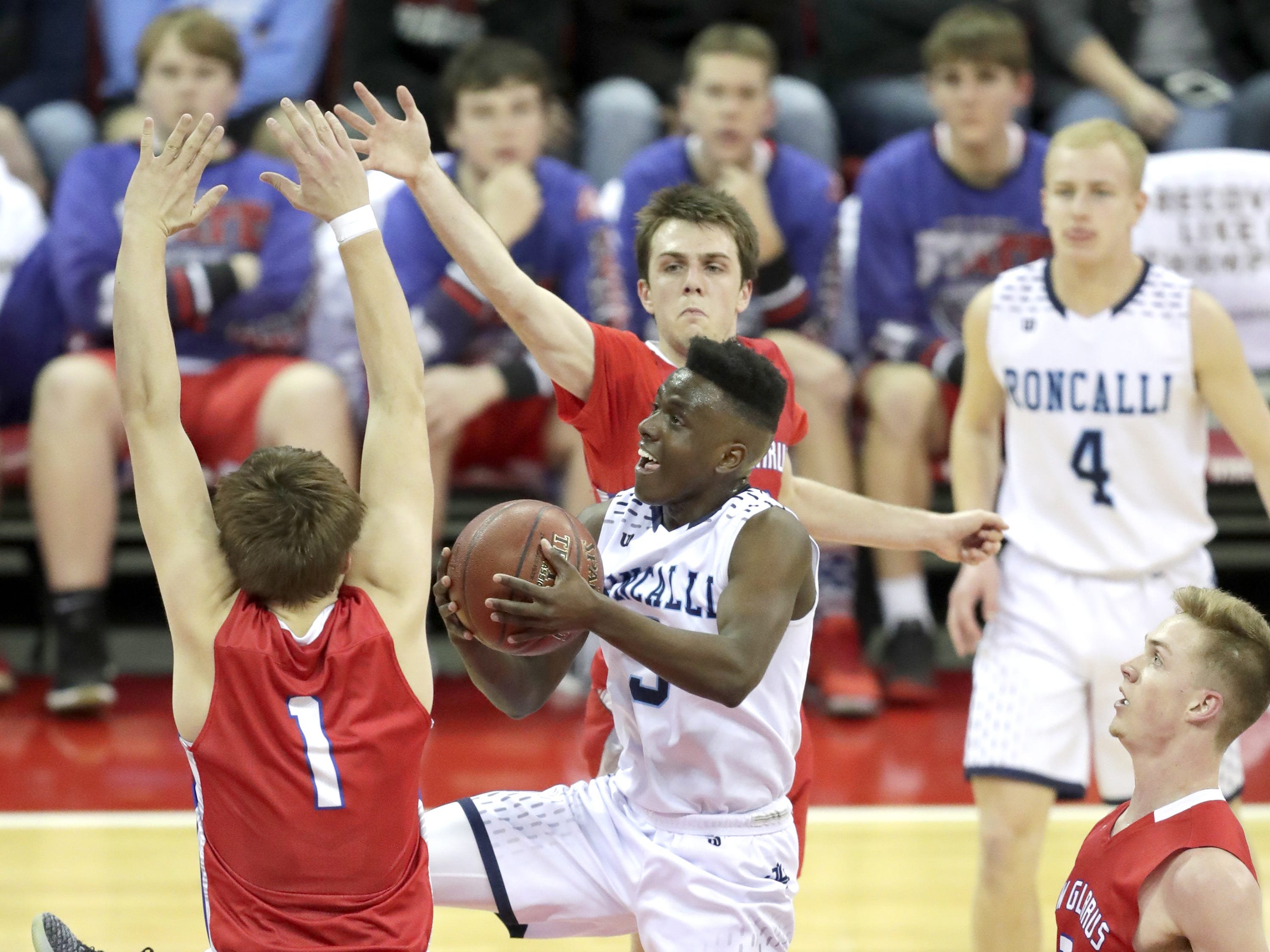 Roncalli High School's #3 Chombi Lambert against New Glarus High School during their WIAA Division 4 boys basketball state semifinal on Thursday, March 14, 2019, at the KohlCenter in Madison, Wis.  Wm. Glasheen/USA TODAY NETWORK-Wisconsin.