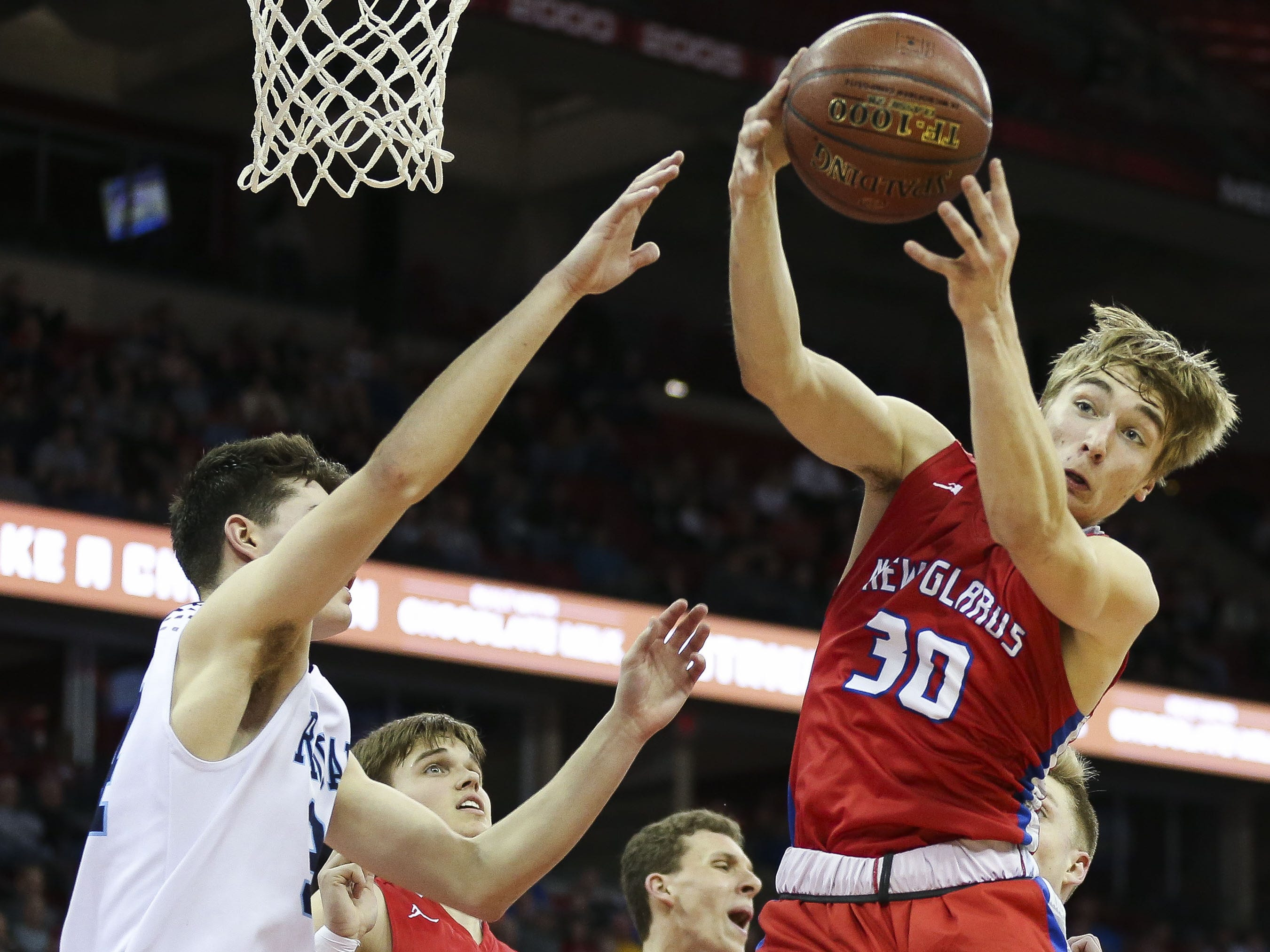 New Glarus High School's Trevor Gassman (30) pulls down a rebound against Roncalli High School in a Division 4 boys basketball state semifinal on Thursday, March 14, 2019, at the Kohl Center in Madison, Wis. New Glarus won the game, 44-41, to advance to Saturday's championship game. Tork Mason/USA TODAY NETWORK-Wisconsin