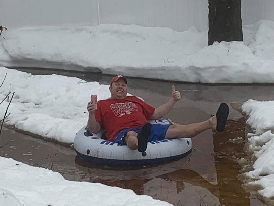 Randy Spiehs of Barron enjoys a tube ride on his makeshift lazy river this week.