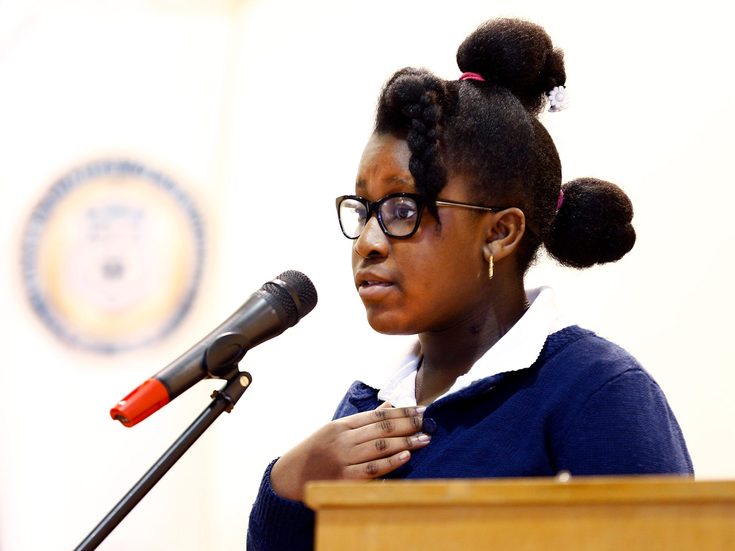 Sisters Academy 5th grader Abigaille Volcy recites a poem during the 8th Annual Miller Speaking Contest at the Asbury Park school Thursday, March 14, 2019.