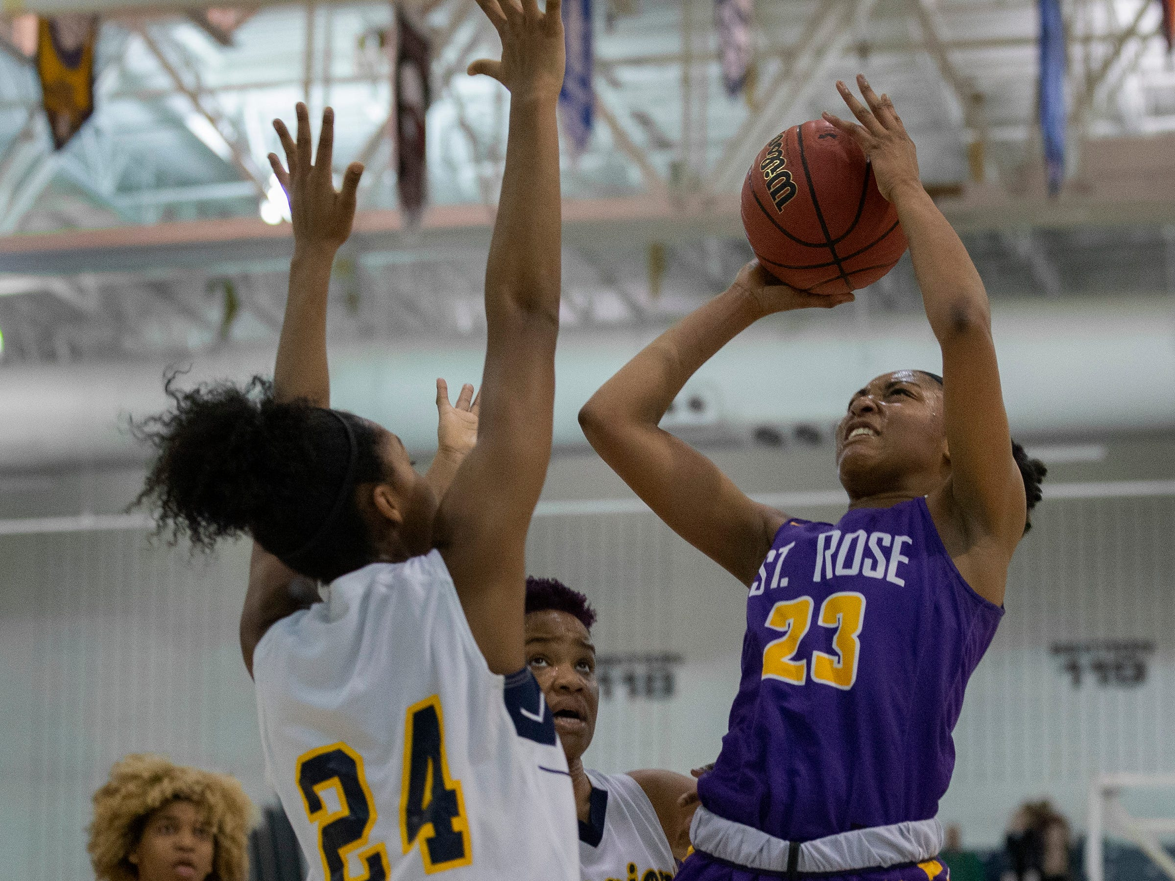 Makayla Andrews, St Rose goes up with shot againts Christina Midgette, Franklin. St Rose Girls Basketball vs Franklin High School in NJSIAA Tournament of Champions Semifinal in Toms River on March 14, 2019.