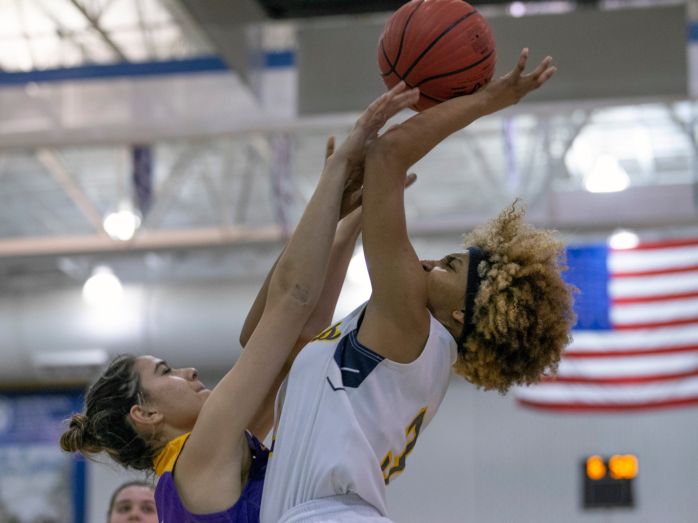 Samantha Mikos, St. Rose,  tries to block shot by Tiana Jackson, Franklin. St Rose Girls Basketball vs Franklin High School in NJSIAA Tournament of Champions Semifinal in Toms River on March 14, 2019.