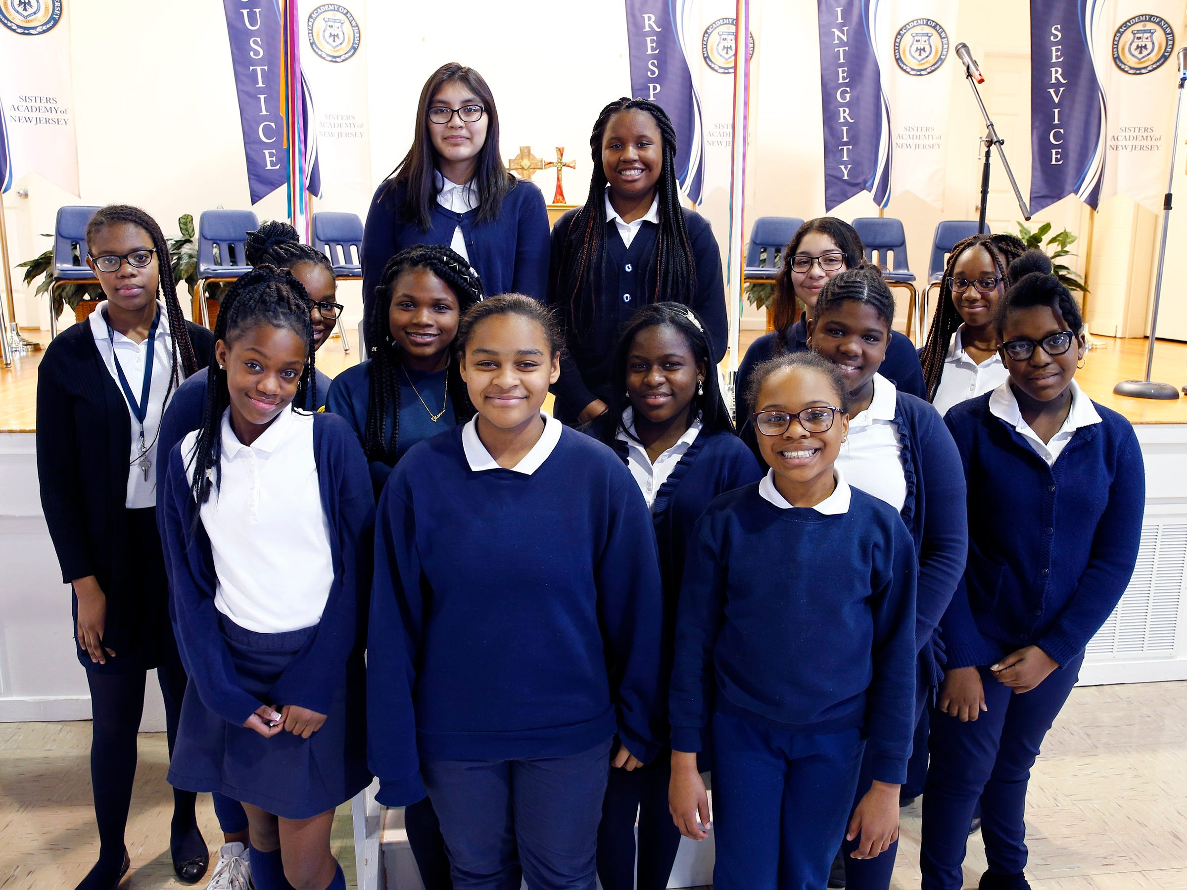 The students competing during the 8th Annual Miller Speaking Contest at the Sisters Academy in Asbury Park gather for a group photo before the competition Thursday, March 14, 2019.