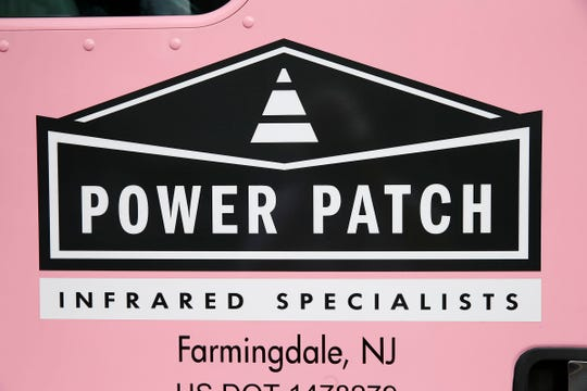 A logo on one of the truck doors at Power Patch Infrared Specialists in Farmingdale, NJ, Friday, March 15, 2019.