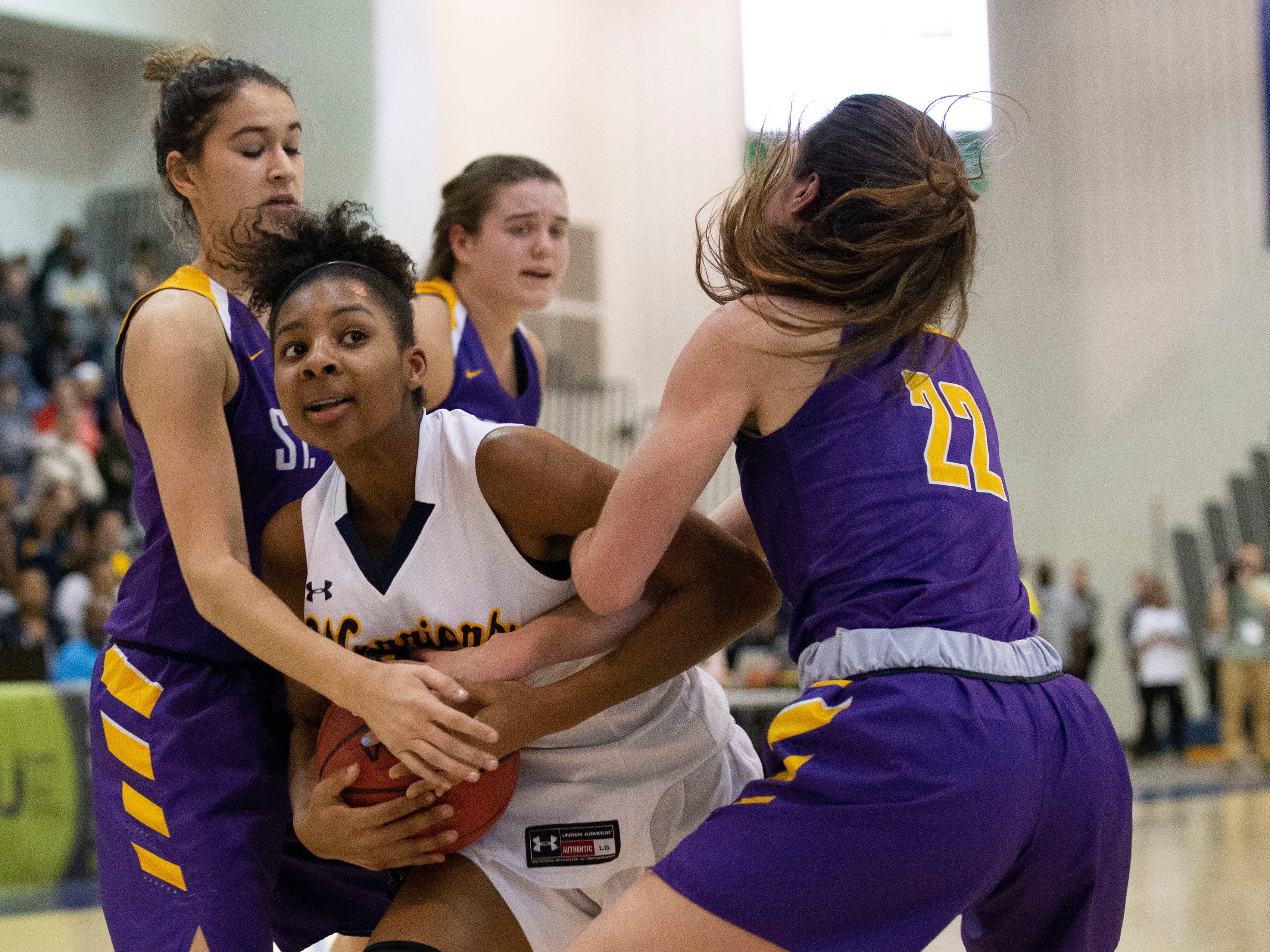 Christina Midgette, Franklin batles for ball with a crowd of St. Rose players during first half action. St Rose Girls Basketball vs Franklin High School in NJSIAA Tournament of Champions Semifinal in Toms River on March 14, 2019.
