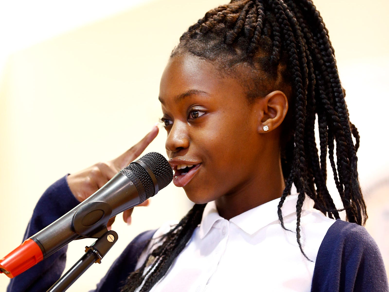 Sisters Academy 5th grader Sanai Tillman recites a poem during the 8th Annual Miller Speaking Contest at the Asbury Park school Thursday, March 14, 2019.