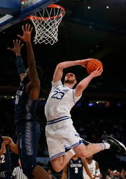 Seton Hall Pirates forward Sandro Mamukelashvili (23) goes to the basket against Georgetown Hoyas center Jessie Govan (15)