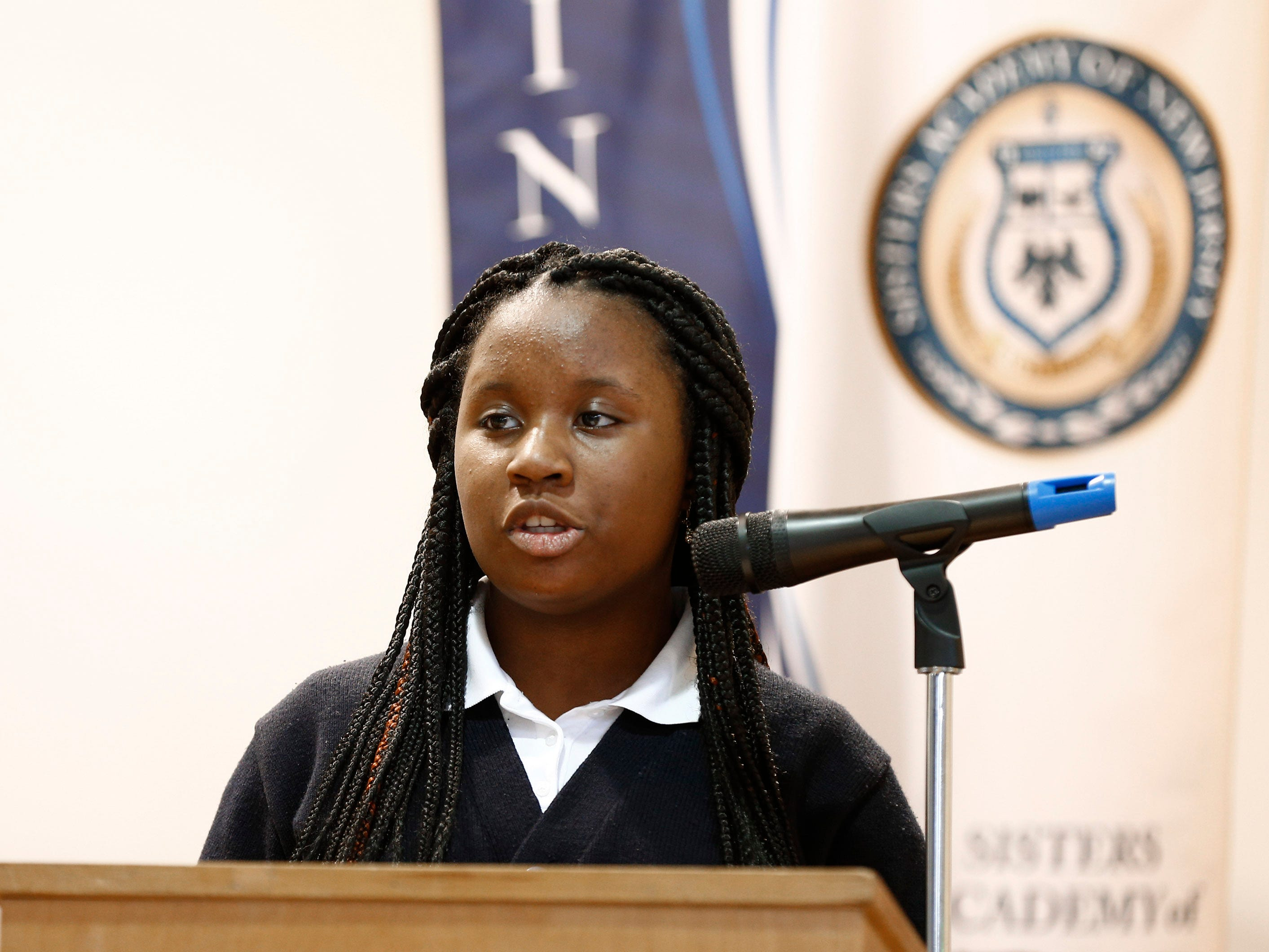 Sisters Academy 8th grader Chrismonde Napoleon performs her core knowledge speech during the 8th Annual Miller Speaking Contest at the Asbury Park school Thursday, March 14, 2019.