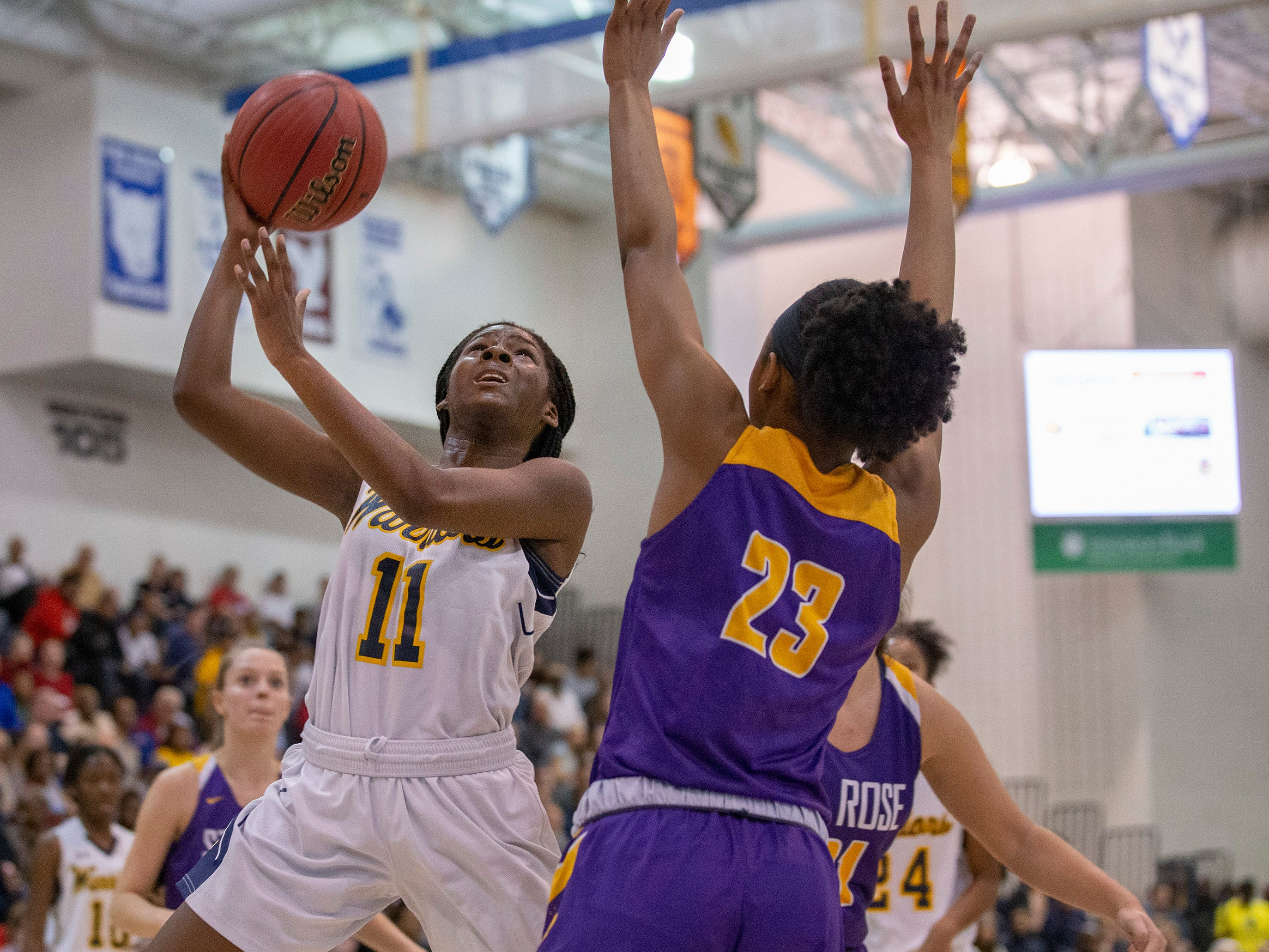 Franklin's Kennady Schenck goes up with shot as Makayla Andrews tries to block her. St Rose Girls Basketball vs Franklin High School in NJSIAA Tournament of Champions Semifinal in Toms River on March 14, 2019.