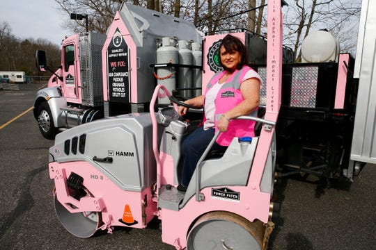 Kimberly Mazzoni, owner of Power Patch Infrared Specialists, is shown with some of her company equipment outside the Farmingdale, NJ, based business Friday, March 15, 2019.