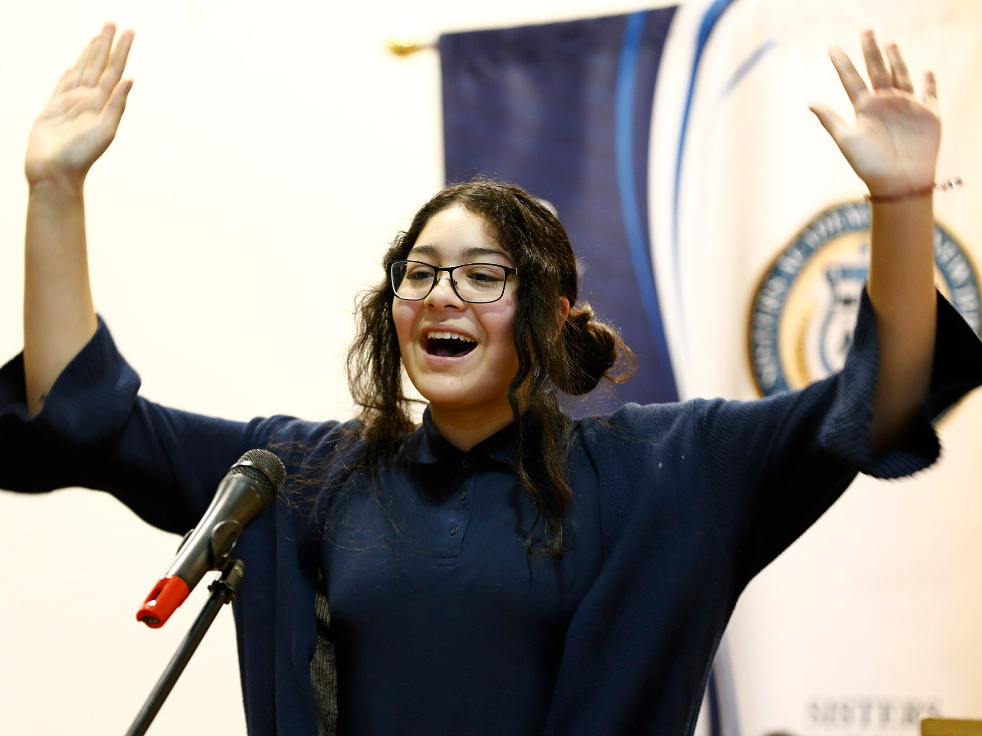 Sisters Academy 6th grader Geraldine Muniz performs during the 8th Annual Miller Speaking Contest at the Asbury Park school Thursday, March 14, 2019.
