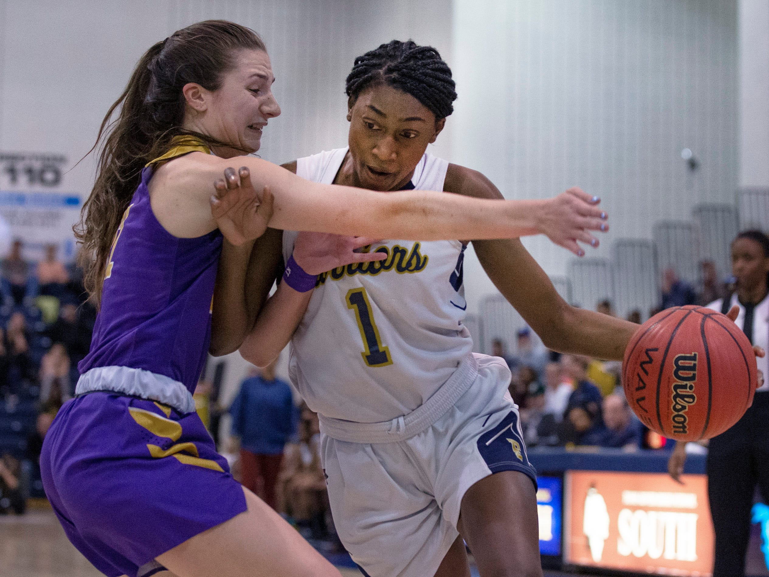 Diamond Miller, Franklin, drives in against Brynn Farrell. St Rose Girls Basketball vs Franklin High School in NJSIAA Tournament of Champions Semifinal in Toms River on March 14, 2019.