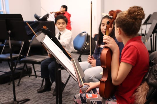 Children rehearse at the Monmouth Conservatory of Music.