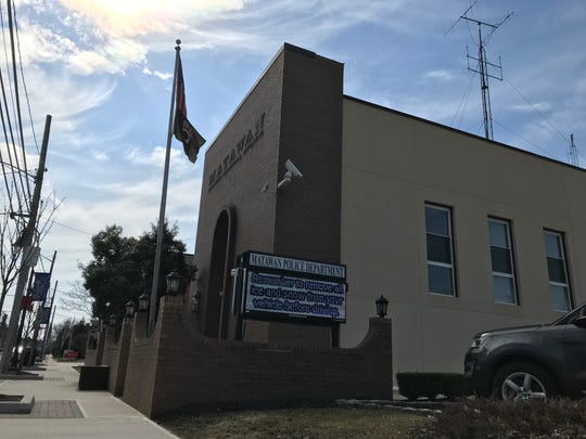 American and POW-MIA flags fly outside Matawan police headquarters on March 14, 2019.
