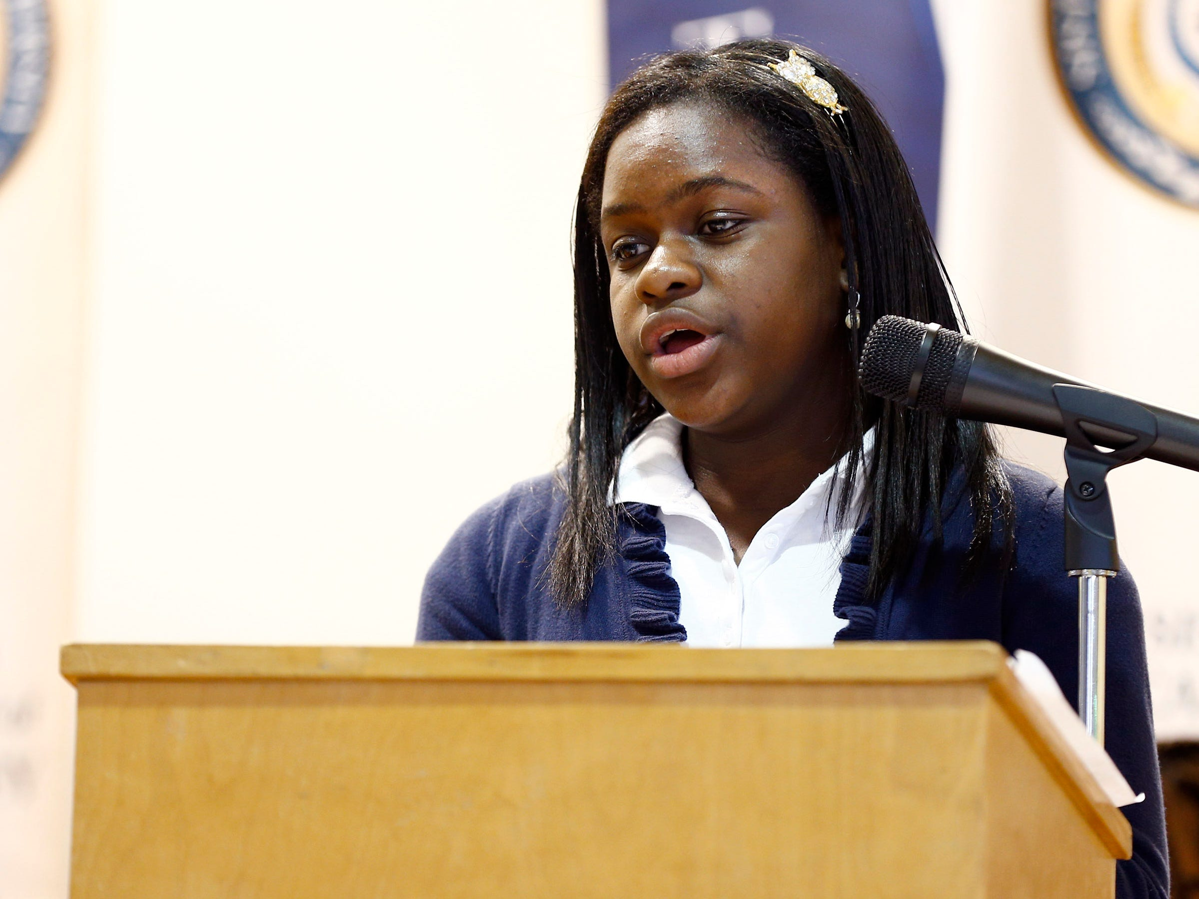 Sisters Academy 7th grader Twayssie Mompoint performs her persuasive essay during the 8th Annual Miller Speaking Contest at the Asbury Park school Thursday, March 14, 2019.