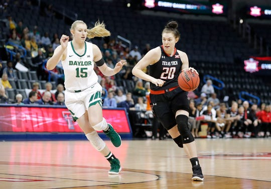 Texas Tech forward Brittany Brewer (20) drives to the basket as Baylor forward Lauren Cox (15) defends during the first half of their game in the Big 12 women's conference tournament in Oklahoma City on Saturday, March 9, 2019.