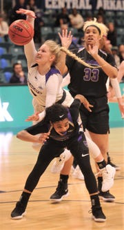 ACU's Kamryn Mraz leaps over a Central Arkansas player for an offensive rebound in the second half.