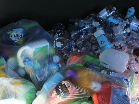 Plastic containers fill a container at an Abilene recycling center. Plastic bags do not qualify as recyclables.