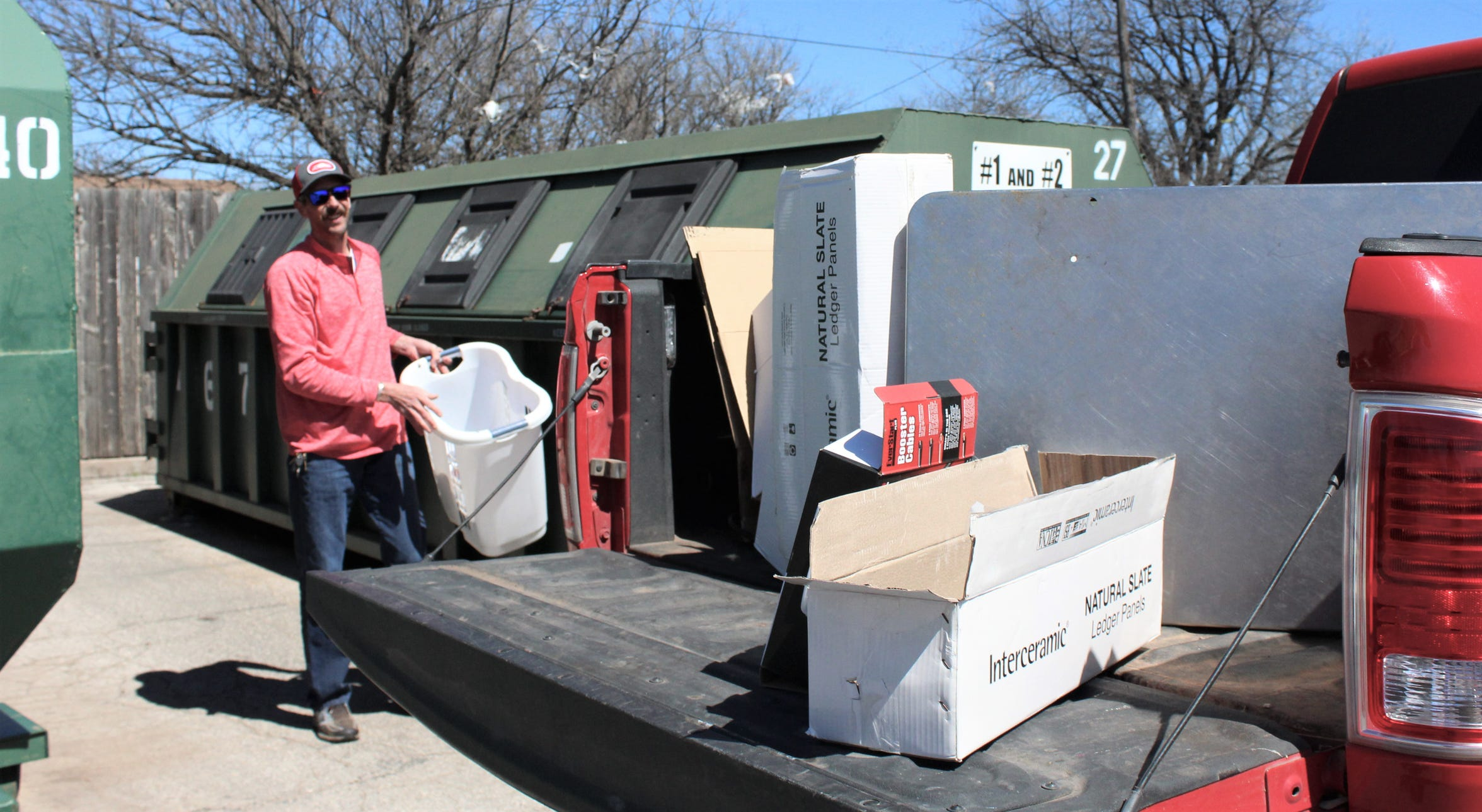 Abilene Chicken Express restaurant owner Evan Parker recycled cardboard and plastic items Friday at the city of Abilene's neighborhood location in the H-E-B parking lot off Barrow Street.