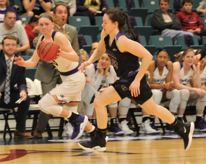ACU's Breanna Wright, left, pushes the ball up court as a Central Arkansas player gives chase. ACU beat the Sugar Bears 82-54 in the second round of the Southland Conference Tournament on Friday at the Merrell Center in Katy