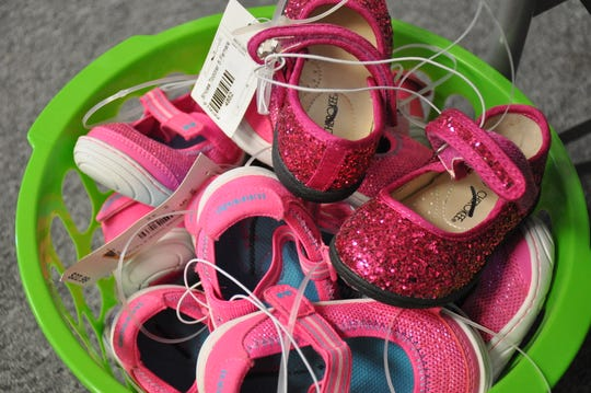 A basket of new shoes is in the Blue Bonnet Room at Texas Child Protective Services Abilene offices.