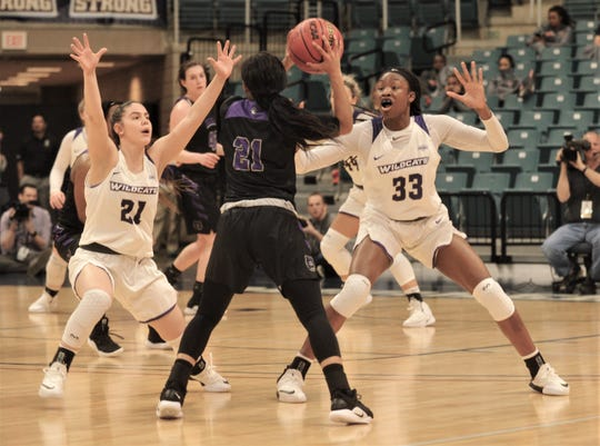 ACU's Kayla Galindo (21) and Alyssa Adams (33) pressure Central Arkansas' Shay Johnson.