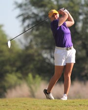University of Mary Hardin-Baylor golfer Cassidy Rawls watches her tee shot. The Snyder grad has played a key role with the UMHB golf women's golf program.